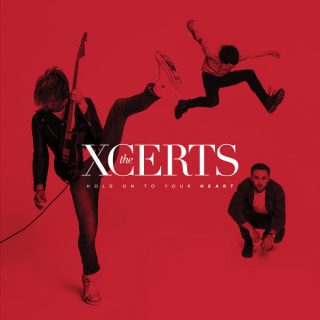 """News Added Jan 18, 2018 Alternative Rock, Pop Rock artist The XCERTS have recently announced their fourth 10-track album, """"Hold on to Your Heart,"""" out on January 19th. The XCERTS plans to drop the upcoming album via Raygun Records. Taking roots in Aberdeen, Scotland, The XCERTS's sound is similar to that of Idlewild and Everything […]"""