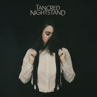 "News Added May 30, 2018 Some know Jess Abbott for her work as the former guitarist of Indie Rock band Now, Now, but others know her as Tancred, the Indie Pop Rock solo project. She's released 3 albums to date, with her fourth on it's way. ""Nightstand"" will be released through Polyvinyl records on June […]"